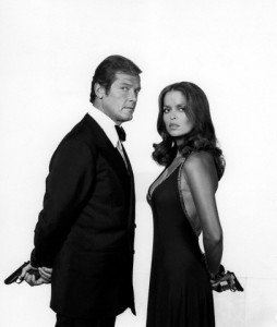 "1977 --- Actor Roger Moore and actress Barbara Bach on the set of ""The Spy Who Love Me"". --- Image by © Sunset Boulevard/Corbis"